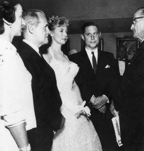Marie McDonald getting married to her fifth husband, Los Angeles banker Edward Callahan, in a civil ceremony at the Flamingo Hotel in Las Vegas (with matron of honor Jean Lansburgh, Flamingo owner Morris Lansburgh, and municipal judge George Treem)August 1962 - Image 3947_0427