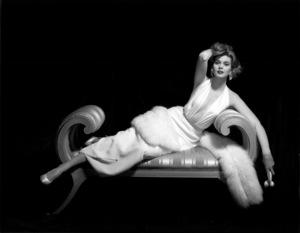 """Fashion"" Plunging neckline dress with fur coatcirca 1955 © 2000 Mark Shaw - Image 3956_0882"