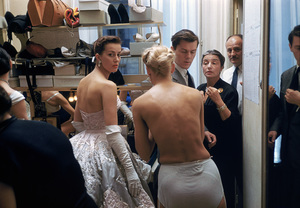 """""""Fashion""""Models backstage at the Pierre Balmain Couture show while the mustached Pierre Balmain stands nearby / Paris, France1954 © 2005 Mark Shaw - Image 3956_0925"""