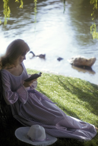 Fashion model reading by a lake1973 © 1978 Sid Avery - Image 3956_0956