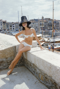 Photographed for the January 1961 issue of LIFE, Christine Mayer poses on the jetty overlooking St. Tropez harbor wearing the year