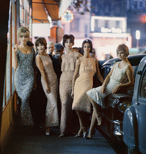 """Fashion models (third and fourth from left (Kouka)) wearing Dior """"Ondine"""" and """"Ciel de feu"""" dresses (Autumn-Winter Haute Couture collection, Charme line).  Also pictured are fashions from Ferreras, Matta and Desses1961© 2013 Mark Shaw  - Image 3956_1052"""