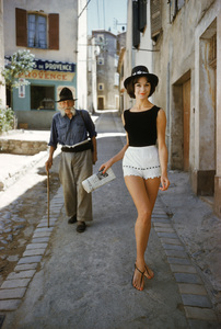 "St. Tropez model in shorts with admirer (photographed by Mark Shaw for the article ""The St. Tropez Way for the U.S.A."" from the January 13, 1961 issue of Life, model ""Irene"" is wearing shorts by Angelo)1961© 2011 Mark Shaw - Image 3956_1080"