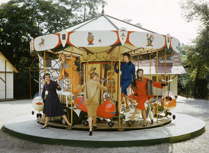 Models on carousel, Bois de Boulogne, Paris (photographed by Mark Shaw for the September 2, 1957 article in Life ìDaytime Suits,î this image was taken at the children