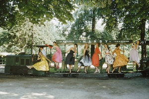 Models on train, Bois de Boulogne, Paris (models clad in designer evening dresses posing on the childrenís miniature train in the Bois de Boulogne as photographed by Mark Shaw for the September 2, 1957 issue of Life.  Designers (left to right) are Lanvin-Castillo, Cardin, Dior, Laroche, Lanvin-Castillo, Cardin, Laroche and Patou)1957© 2011 Mark Shaw - Image 3956_1088