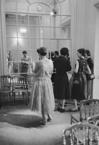 Dior fashion model looking in mirror as photographer Mark Shaw appears in reflection1958© 2013 Mark Shaw - Image 3956_1125
