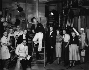 Paul Hesse Studios in West Hollywood, California(L-R) Joan Pearson (Lab Tech), John Kelly (Carbro Printer), Don Hesse, Wallace Seawell (Portrait Photographer), Mario Casilli (Assistant Photographer), Paul Hesse, Glenn Embree (1st Assistant and Associate Photographer), Cathy Gillean (Assistant), Florence Collins (Retoucher), Glen Levitt (Handyman)circa 1950© 1978 Paul Hesse - Image 3985_0089