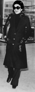 Jacqueline Kennedy-Onassiswearing a Yves St. Laurent coat at London
