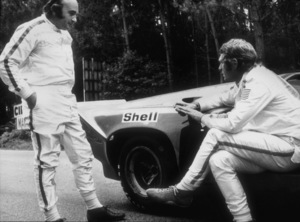 """Le Mans""Steve McQueen and race car driverDavid Piper on the set with a Porsche 9171971 Solar Productions © 1978 Mel TraxelMPTV - Image 4170_0001"
