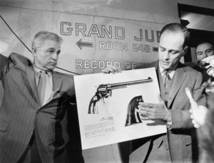 Los Angeles - District Attorney Aaron Stovitz explains a printed sheet of a .22 caliber pistol that he said is part of the case involving the murder of actress Sharon TateDecember 1969 - Image 4203_0055