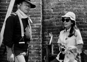 """Rio Lobo,"" Cinema Center 1970. John, Pilar, and Marisa Wayne during a break from filming. © 1978 David Sutton - Image 4229_0009"