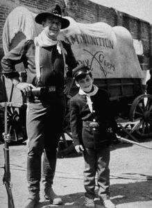"""Rio Lobo,"" Cinema Center 1970.John Wayne and his son, Ethan, during a break from filming. © 1978 David Sutton - Image 4229_0010"