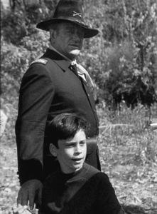 """Rio Lobo,"" Cinema Center 1970.John Wayne and his son, Ethan, during a break from filming. © 1978 David Sutton - Image 4229_0011"
