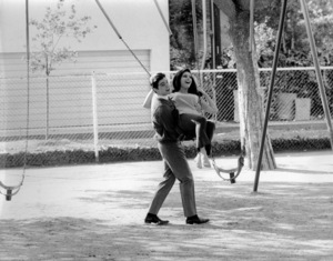 Paul Petersen with Brenda Benet on a swing c. 1965 © 1978 Chester Maydole - Image 4705_0001