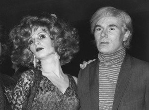 """Andy Warholwith Candy Darling as they arrive at the Manhattan Theater in New York for the premiere of """"Midnight Cowboy""""May 25, 1969MPTV - Image 4795_0002"""