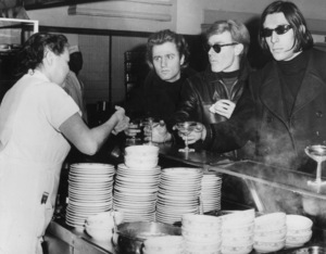 """Andy Warhol with poet Gerard Malanga and musician John Caleat a champagne breakfast held at the Automat in New York following the premiere of """"Our Man Flint""""January 25, 1966MPTV - Image 4795_0024"""