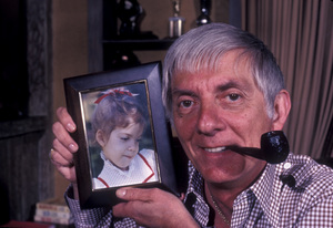 Aaron Spellingat home with a photograph of his daughter Tori Spelling1979 © 1979 Gene Trindl - Image 4814_0009
