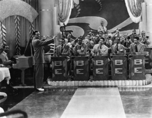 Billy Eckstine and his band (LEFT TO RIGHT: Linton Gomer (piano), Billy Eckstine (leader), Gene Ammons (tenor saxophone), Bill McMahon (bass), Connie Wainwright (guitar), Hobart Dotson (trumpet), Porter Kilbert (alto saxophone), Art Blakey (drums), Leonard Hawkins (drums), Chippie Outcatt (trombone), King Kolax (trumpet), Frank Wess (tenor saxophone), Howard Scott (trombone))1946** I.V.M. - Image 4867_0026