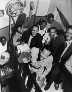 """Billy Eckstine with some of the members of his band (Tommy Potter (bass), Art Blakey (drums), Theodore """"Fats"""" Navarro (rear), Eckstine (front), Budd Johnson (front), Gene Ammons (tenor saxophone))May, 1945** I.V.M. - Image 4867_0027"""