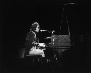 Elton John performing at the Fillmore East in New York Citycirca 1969 © 1978 Gary Legon - Image 4960_0029