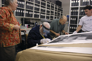 Photographer Richard C. Miller signing prints at The Motion Picture & Television Photo Archive in Van Nuys, California with his daughter Jan, archivist Joe Martinez and MPTV President Ron Avery / 02-15-2007 © 2007 Andrew Howick - Image 5043_0014