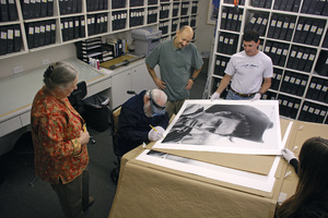 Photographer Richard C. Miller signing prints at The Motion Picture & Television Photo Archive in Van Nuys, California with his daughter Jan, archivists Joe Martinez and Beth Jacques, and MPTV President Ron Avery / 02-15-2007 © 2007 Andrew Howick - Image 5043_0017