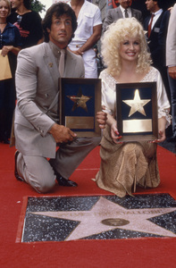 Sylvester Stallone and Dolly Parton at the unveiling of his Star on the Hollywood Walk of FameJune 14, 1984** B.D.M. - Image 5184_0090