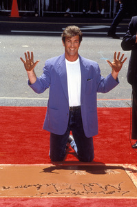 Mel GibsonPlacing handprints at the Mann Chinese Theater in Hollywood, CA1993 © 1993 Pablo Grosby - Image 5215_0031