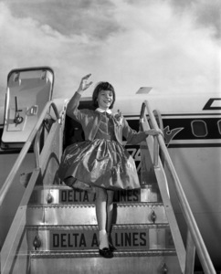 """Mary Badham exiting a Delta airplane during press for the film """"To Kill a Mockingbird""""1962*** B.D.M. - Image 5344_0034"""