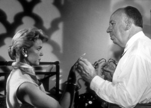"""""""Man Who Knew Too Much, The""""Doris Day with Director Alfred Hitchcockon the set. 1956/Paramount. © 1978 Bill Avery - Image 5372_0030"""
