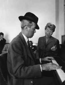 """James Stewart and Doris Day at the piano on the set of """"The Man Who Knew Too Much"""" 1956 © 1978 Sanford Roth / A.M.P.A.S. - Image 5372_24"""