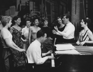 "Leonard Bernstein rehearsing with members of the stage cast of ""West Side Story"" (Stephen Sondheim is on the piano)1957 Photo by Friedman-Abeles** B.D.M. - Image 5373_0054"