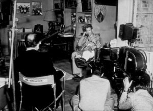 """Rear Window,"" James Stewart on the set while Alfred Hitchcock directs.1954 Paramount - Image 5375_0015"