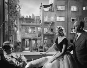 "James Stewart, Grace Kelly, and director Alfred Hitchcock on the set of ""Rear Window""1954** I.V. - Image 5375_0019"