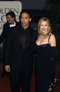 """Madonna and Carlos Leon at """"The 54th Annual Golden Globe Awards""""1997 © 1997 Gary Lewis - Image 5384_0048"""