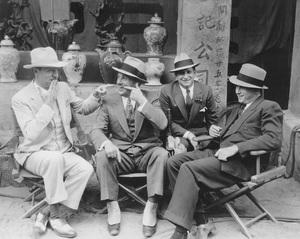 "Warner HistoryWilliam Powell, Jack Warner, William Koenig, Tay Garnett on a Hong Kong street set for ""One Way Passage""1932 - Image 5460_0149"