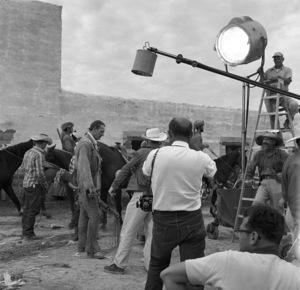 "Photographer Bernie Abramson shooting John Wayne on location during the filming of ""The Alamo""1960 © 1978 Bernie Abramson - Image 5499_0006"