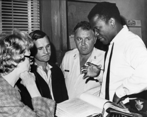 """""""In the Heat of the Night""""Sidney Poitier, director Norman Jewison, Rod Steiger1967 United Artists - Image 5502_0076"""