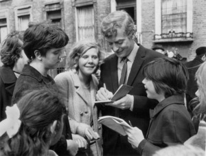 """Michael CaineSigning Autographs on the set of""""Alfie""""1966 - Image 5705_0112"""