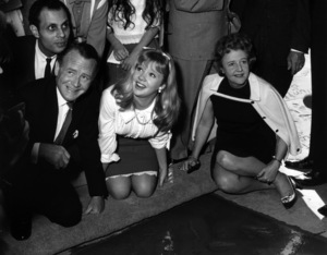 Hayley Mills with parents John Mills and Mary Hayley Bell in front of Grauman