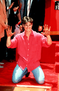 Tom Cruise puts his hand prints in cement at the Mann