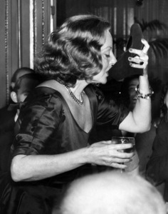 Tallulah Bankhead uses a shoe for a glass during a  reception at the Ritz Hotel in London 1951** I.V. - Image 5731_0461