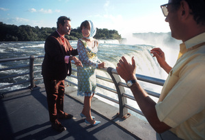 """Director Clive Donner watches Jack Lemmon and Elaine May rehearse on the parapet overlooking Niagara Falls, during the making of """"Luv""""1966 Columbia Pictures © 1978 Bob Willoughby - Image 5736_0022"""