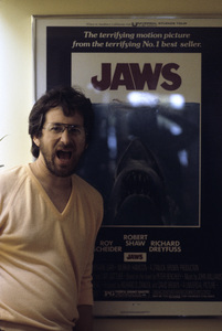 """Steven Spielberg in front of the movie poster for """"Jaws"""" 1982© 1982 Bruce McBroom - Image 5817_0058"""