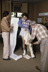 """Steven Spielberg going over the end titles for """"Poltergeist"""" with Frank Marshall, while also having his pants fitted by his tailor1982© 1982 Bruce McBroom - Image 5817_0079"""