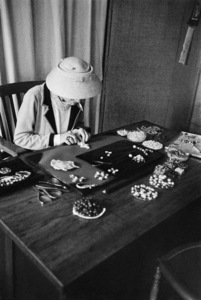 Coco Chanel looking over a table of jewels1957 © 2000 Mark Shaw - Image 5970_0032