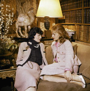 Coco Chanel in her Paris apartment over her fashion house on Rue Cambon with Jeanne Moreau 1957© 2011 Mark Shaw - Image 5970_0044