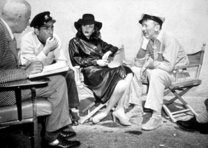 """To Have and Have Not""Director, Howard Hawks, Humphrey Bogart, Delores Moran, and Walter Brennan1945 Warner Bros.Photo by Floyd McCartyMPTV - Image 5983_0008"