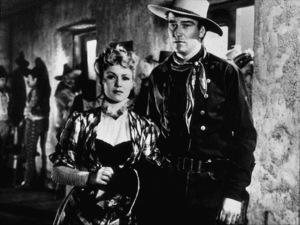 """Stagecoach""Claire Trevor and John Wayne. © 1939 United ArtistsPhoto by Ned Scott - Image 6015_0119"