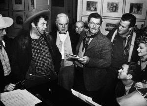 """Stagecoach,"" United Artists 1939.John Carradine, Andy Devine, Barton Churchill, Donald Meek, John Wayne, and Claire Trevor.Photo by Ned Scott - Image 6015_0130"